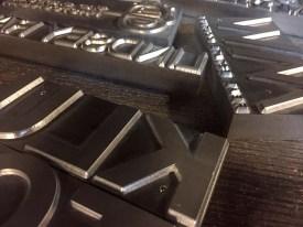 Mullenberg Designs magnesium die for logo de-bossing