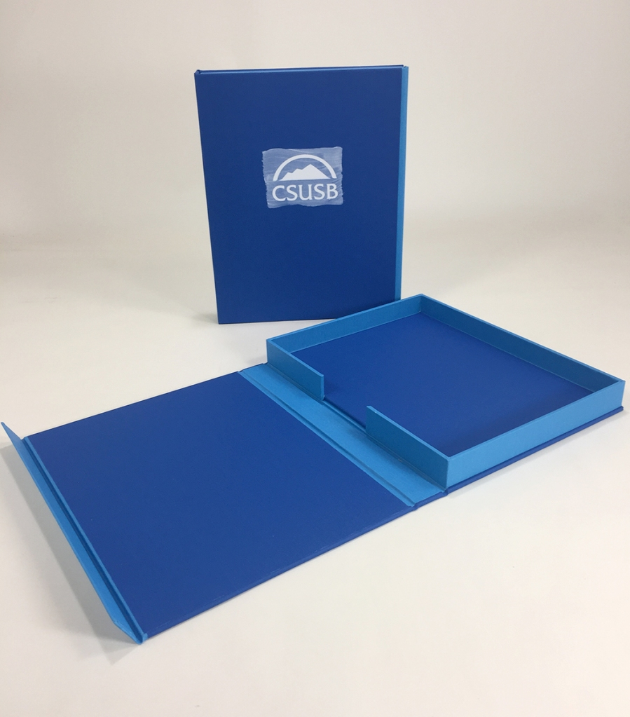 Custom Clamshell Presentation Cases with Hand-painted & Debossed Logo treatments built by Mullenberg Designs